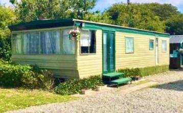 PHOTOS: Escape to the beach! Seaside holiday home for sale